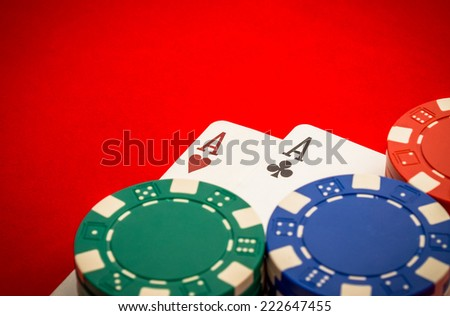 Chips and pair of aces - stock photo