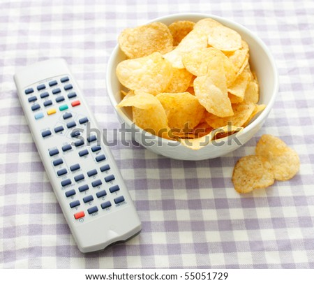Chips and remote - stock photo