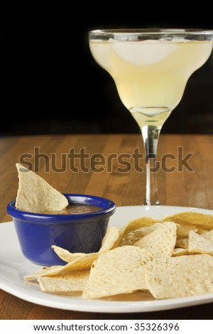 Chips and salsa, with a tasty margarita - stock photo