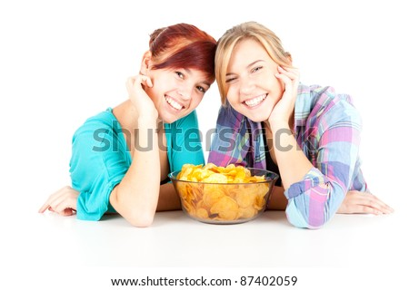 chips and teenage girl friends leaning on the table