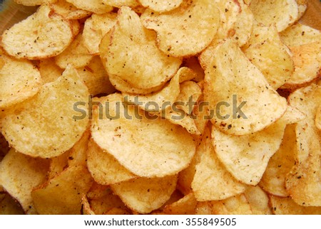 chips crisps on plate texture - stock photo