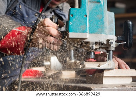 Chips fly from the processing of milling machine parts. - stock photo