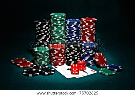 chips for poker with pair of aces and dice - stock photo