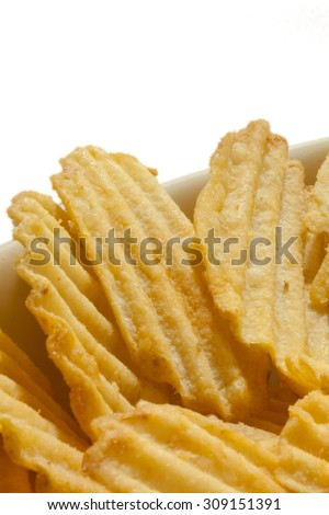 Chips potatoe in close view with white background.