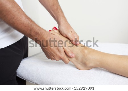 chiropractor applying myofascial therapy    - stock photo