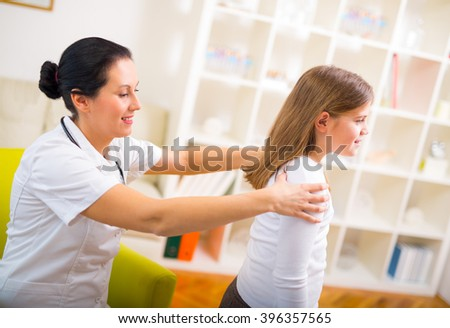 Chiropractor doing adjustment on female patient - stock photo