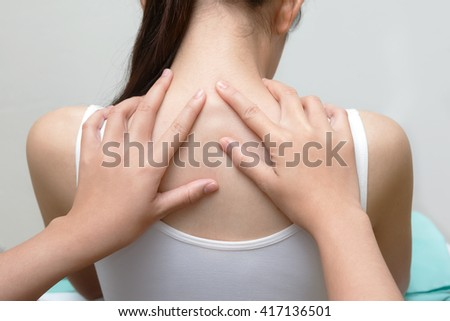 Chiropractor examines spinal column of patient woman, medical concept - stock photo
