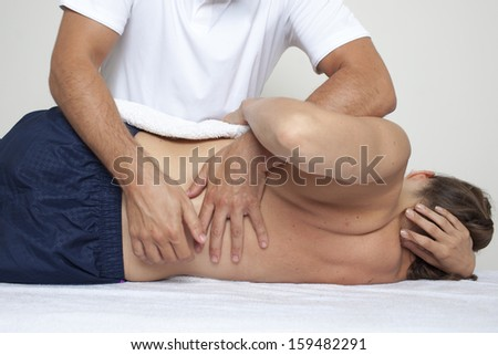 Chiropractor exercising female myofascial therapy   - stock photo