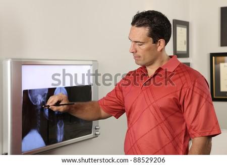 Chiropractor with xray - stock photo