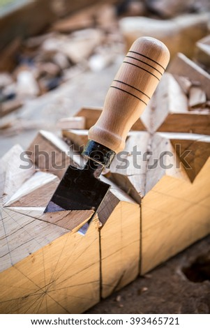 Chisels resting in a workbench near sawdust and trimmings. - stock photo