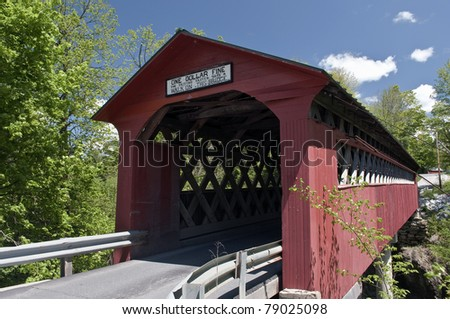 Chiselville Covered Bridge in Sunderland, Vermont with an interesting sign:  One Dollar Fine for Driving Faster than a Walk on this Bridge