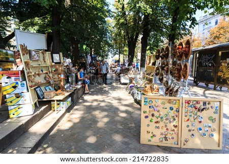 CHISINAU, MOLDOVA- AUGUST 21, 2014: Tourists and locals looking at the stalls at Chisinau flea market in Moldova. At the flea market one can find second hand clothes and shoes, souvenirs and paintings