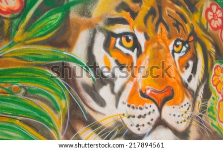 Chisinau, Moldova - May 24, 2014: Zoo. Painted wall with acrylic sprays- tiger in the jungle.Background. - stock photo