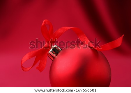 Chistmas ball on silk background