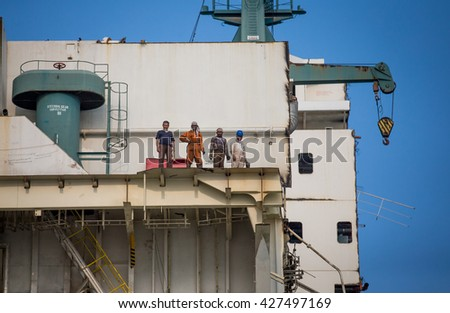 Chittagong, Bangladesh - circa February 2016: workers of a ship breaking yard on a partially broken down ship