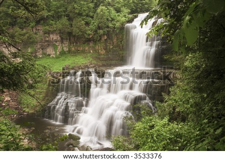 Chittenango Falls in central New York state. This beautiful waterfall tumbles across many rock ledges on its way downstream. - stock photo