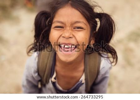 CHITWAN PARK, NEPAL - NOVEMBER 24: Unidentified Child of Nepal laughing in Chitwan Park on November 24, 2014 in CHITWAN PARK, Nepal - stock photo