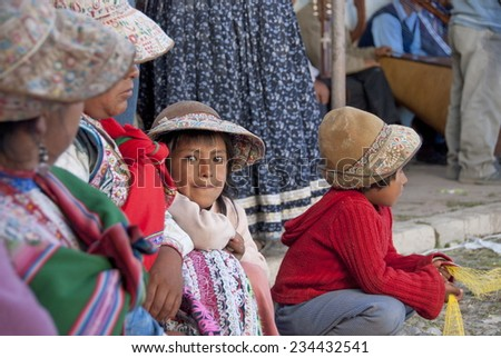 CHIVAY, PERU - MAY 4: Unidentified Quechua people at annual village's harvest celebration on May 4, 2010 in Chivay, Arequipa region, Peru. National clothes are common for Quechua people in rural Peru. - stock photo