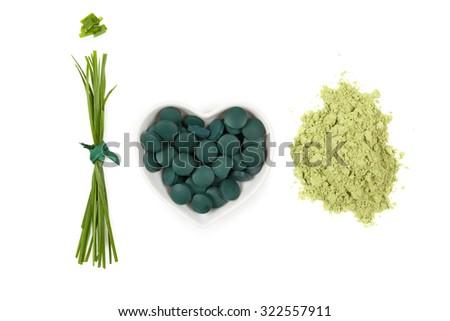 Chlorella, spirulina and wheatgrass. Green superfood, detox, healthy living,  - stock photo