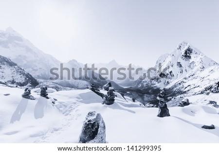Cho La pass and snowed peaks at dawn in Himalaya. Travel to Nepal - stock photo