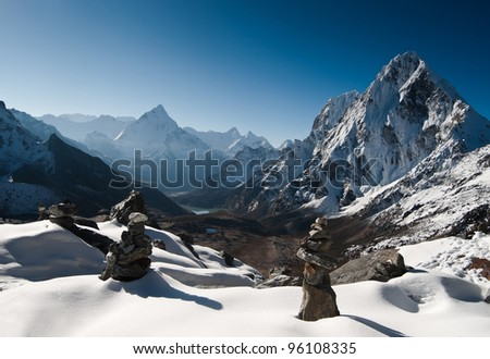 Cho La pass and stone stacks at daybreak in Himalayas. Hiking in Nepal - stock photo
