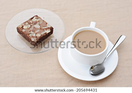 Chocolate Almond Brownie and Hot cup of coffee on Pure cotton
