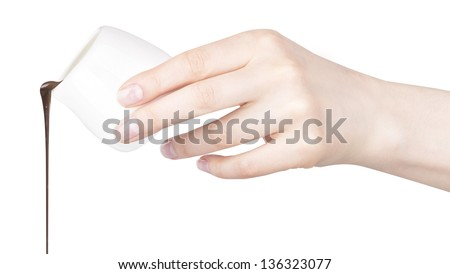 chocolate and and human hand isolated on a white