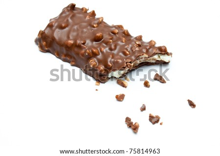 Chocolate and cheese dessert bit and crumbs isolated on white