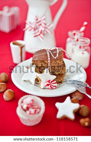 Chocolate and christmas cookies on a red background