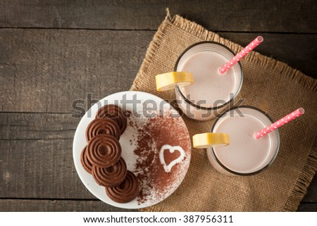 Chocolate and Coconut Cookies and Cream Milkshake in a Glass on Wooden Table. Banana smoothie, iced cocoa and latte. - stock photo