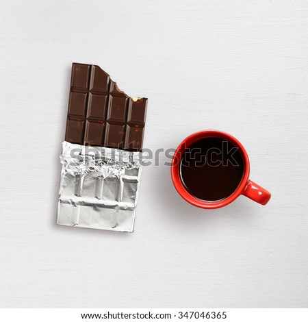 Chocolate and coffee cup on white table - stock photo