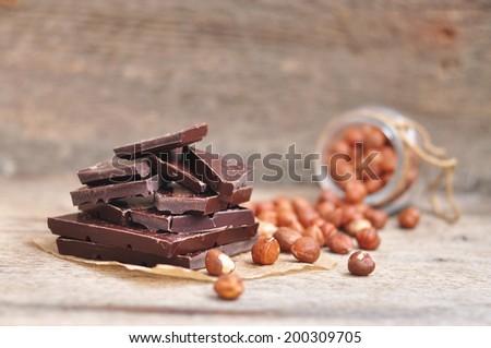 Chocolate and hazelnuts, selective focus - stock photo