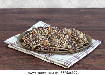 Chocolate and nut cookies made with crackers.  Copy space. - stock photo