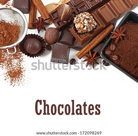 Chocolate and spices isolated on white background - stock photo