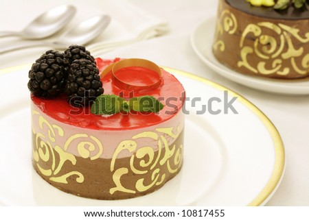 Chocolate and strawberry layer mousse cake - stock photo