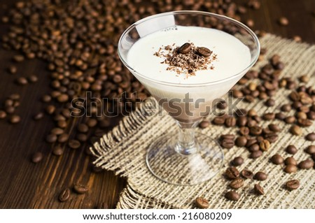 chocolate and vanilla panna cotta with coffee beans - stock photo