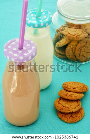 Chocolate and white milk and ginger cookies in verical format and shot in natural light
