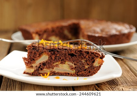 Chocolate apple cake on wooden background horizontal closeup macro - stock photo
