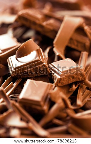 Chocolate background. Bars and strips of chocolate. Shallow depth of field - stock photo