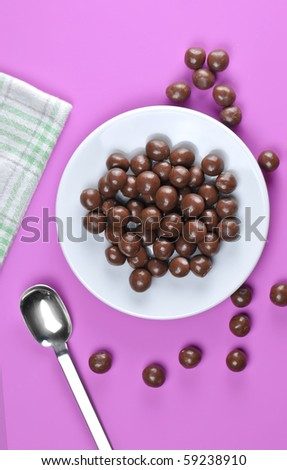 Chocolate ball`s served on plate on pink background - stock photo