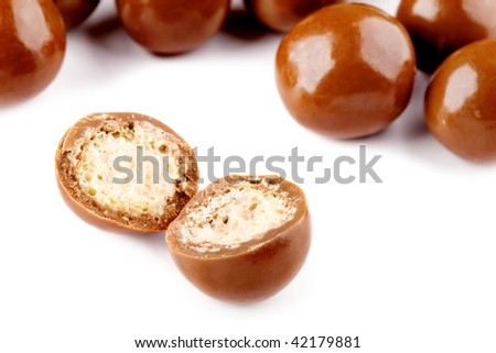 Chocolate balls and a half with crisp filling isolated on white - stock photo