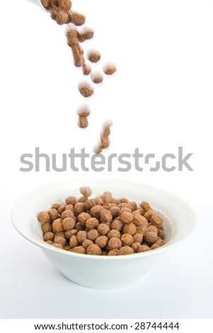 Chocolate balls falling in ceramic bowl-blur representing motion. Isolated on white. - stock photo