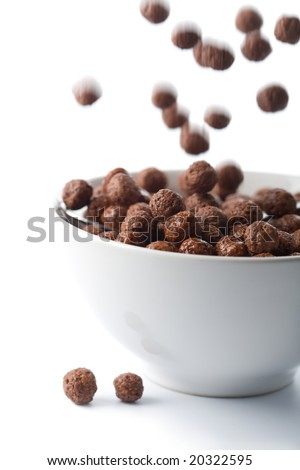 chocolate balls falling into bowl isolated - stock photo