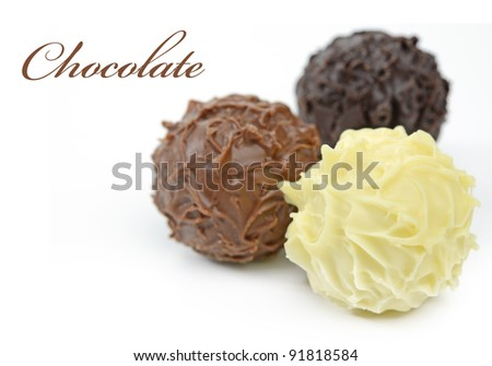 Chocolate balls with shallow depth of field - stock photo