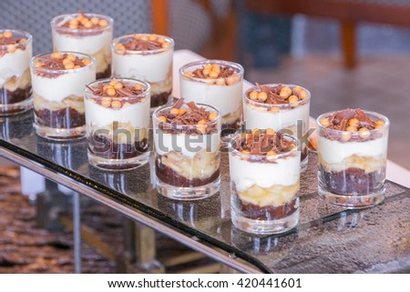 Chocolate Banana banoffee Cream Pie Dessert in short glass , selective focus - stock photo