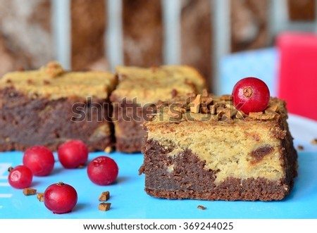 chocolate banana brownies with cream cheese. red currant berries.