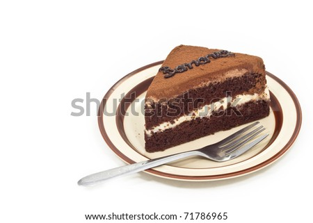 Chocolate banana cake in plate with fork on white background - stock photo