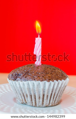 Chocolate banana cupcake on red background - stock photo