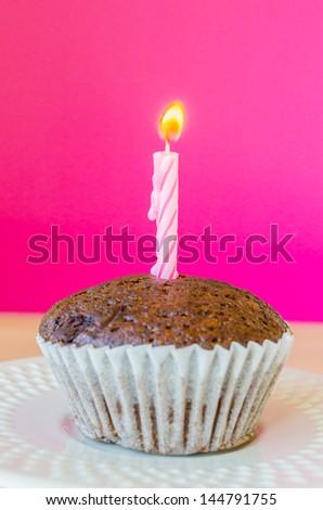 Chocolate banana cupcake with pink&purple background - stock photo