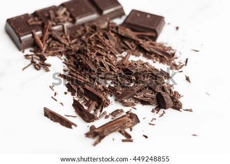 chocolate bar and shavings on white background - stock photo